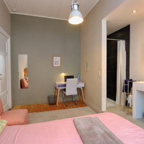 furnished pink bedroom with shower to rent in a shared space