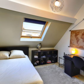 stylish bedroom to rent with black desk and world map near Place des Chasseurs Ardennais
