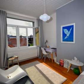 furnished and well-decorated room in a co-living house in a lively place