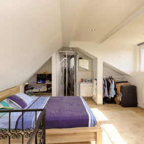 bedroom with double bed and private shower in a home to share with expats