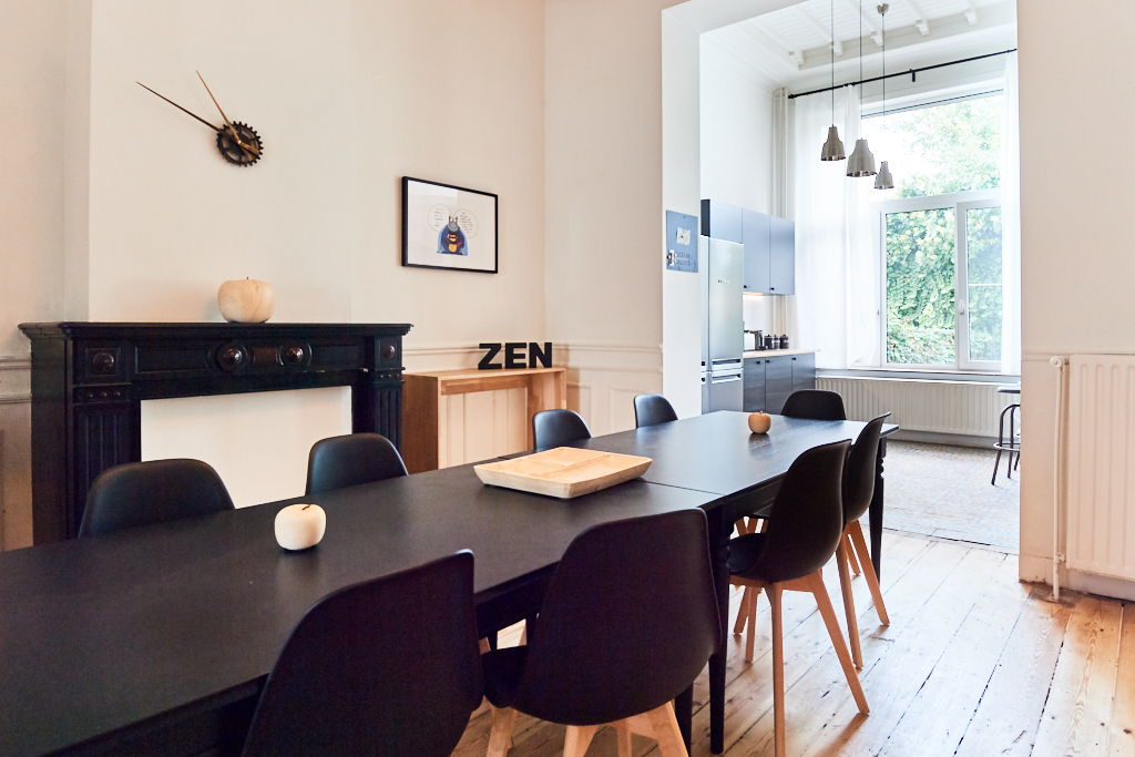 beautiful dining room with design furniture in a shared house for expats