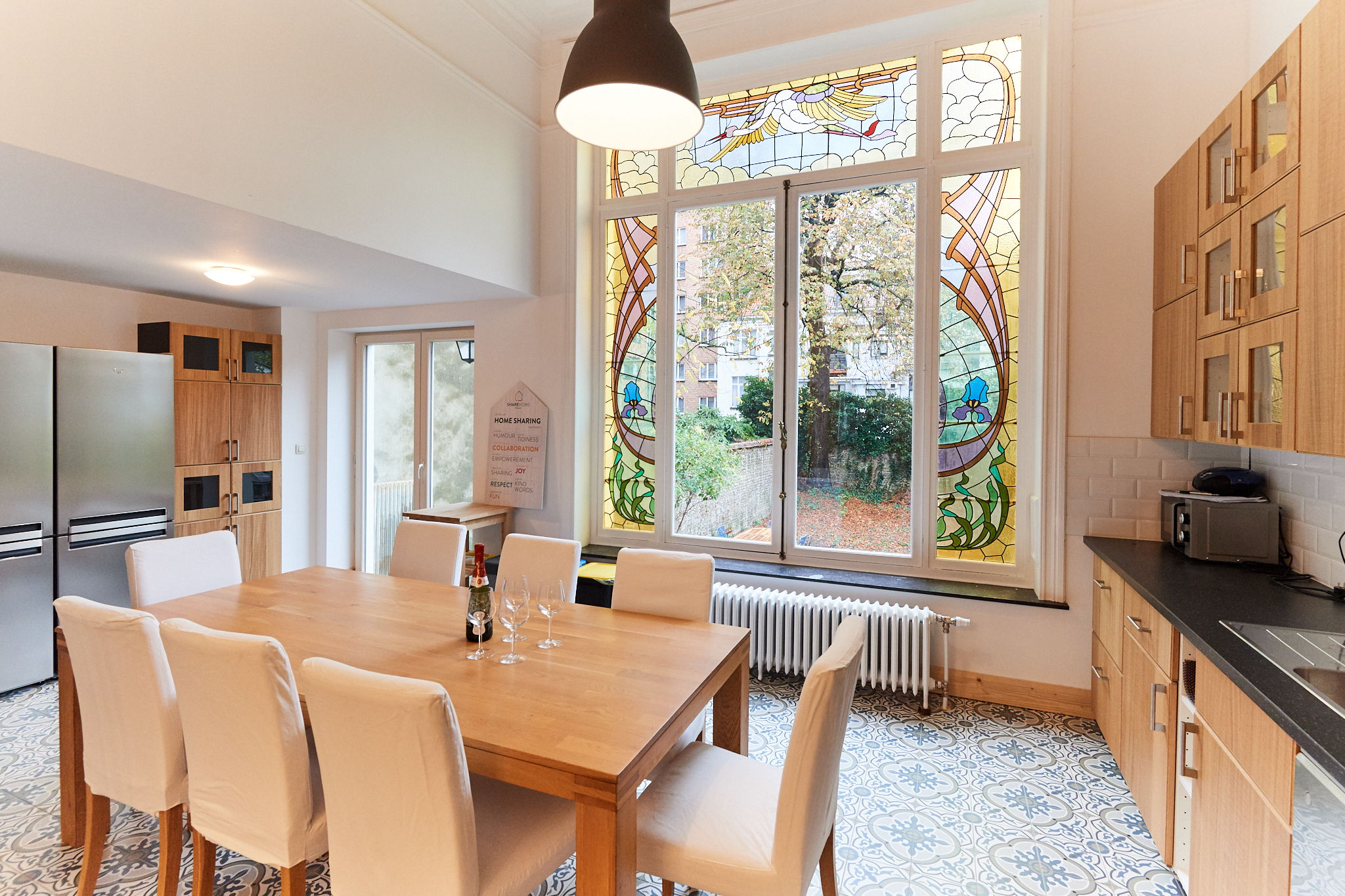 fully-equipped kitchen including oven and microwave and with magnificent original 19th century stained glass windows