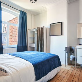 well-decorated comfortable room with private shower and toilet in a shared house in Brussels
