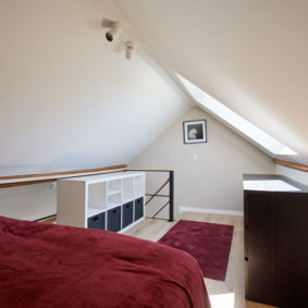 large bedroom to rent with a mezzaine including a comfortable double bed and a private shower