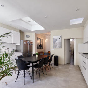 fully equipped kitchen with a design dining table in a fully refurbished house for expats close to the European Comission