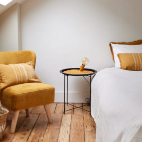 room with a double bed decorated in a sunny style in a share house in Brussels