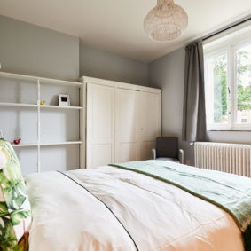 room decorated with style and a comfortable double bed in a shared home