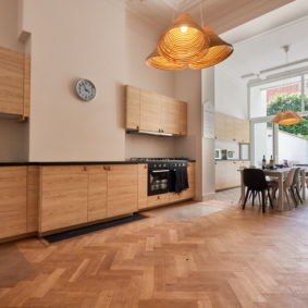 fully equipped kitchen including oven and microwave in a fully renovated co-housing in Brussels