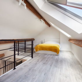 high-end room with a comfortable double bed and a private shower in a shared flat in Brussels