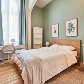 large room with a private shower for a young professional in a shared house for expats