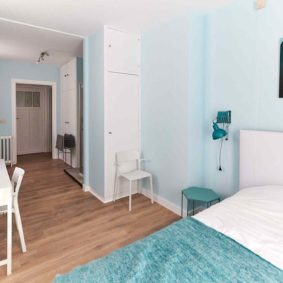 beautifully decoratd room with a double bed and a private shower in a coliving house for expats in Brussels