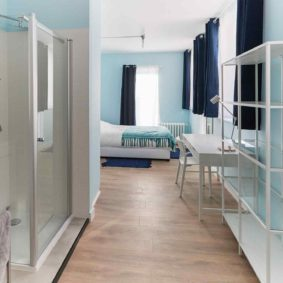 well designed blue style room with comfortable double bed in a sharedd house in Brussels