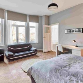 furnished room with a stylish sofa and a private shower in a shared house in Brussels