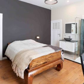 well-decorated bedroom with private shower in a shared house in Brussels