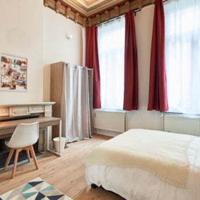 well designed room with quality furniture and a private shower in a house sharing in Brussels