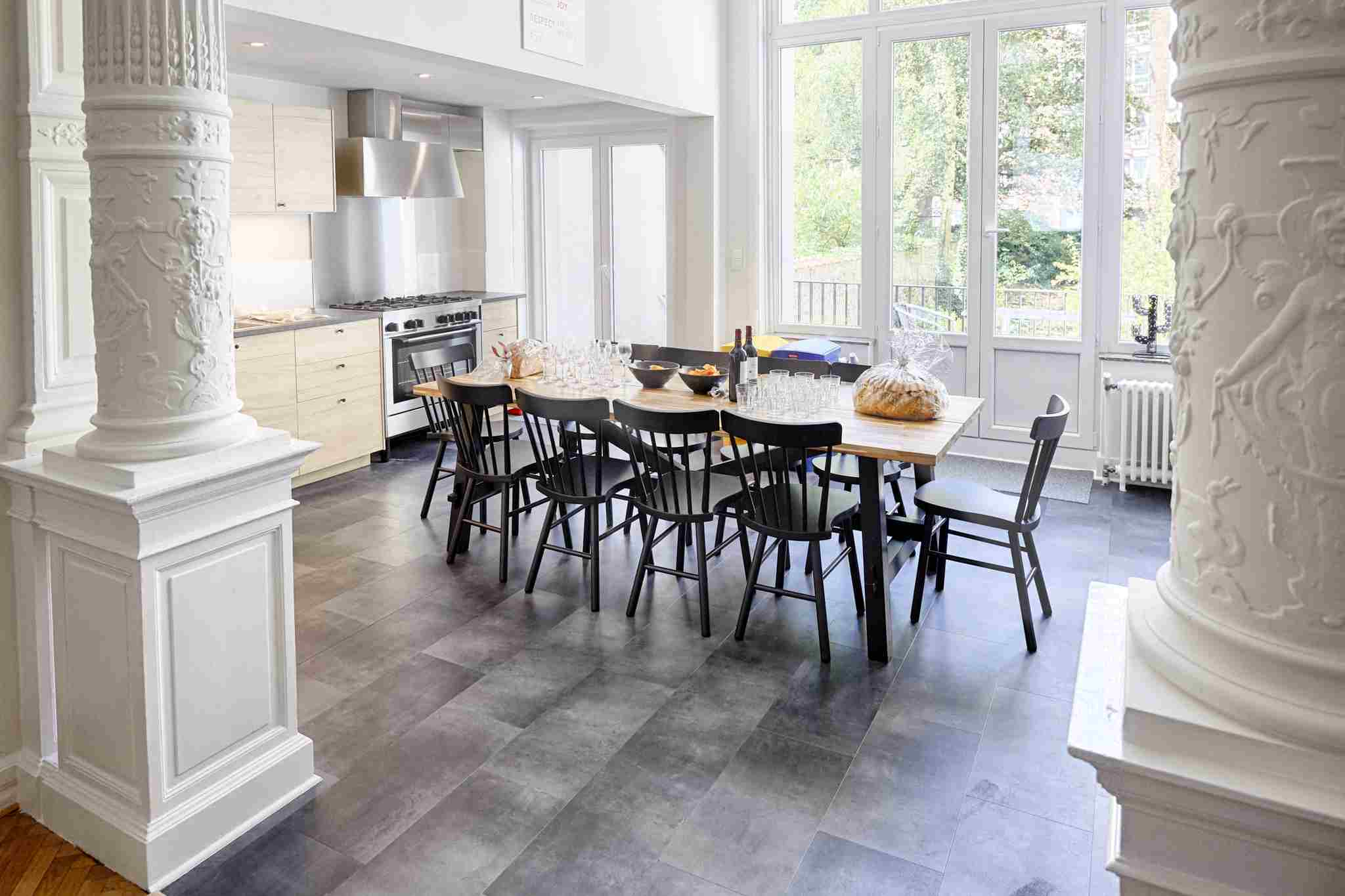 fully equipped kitchen with oven and microwave and stylish dining table in a cohousing space in Brussels