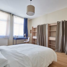 comfortable and furnished room including a dressing and a private shower in a coliving space for expats in Brussels
