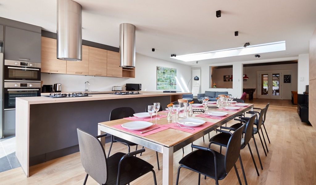 fully equipped kitchen with a design dining table in a shared house for expats in Brussels