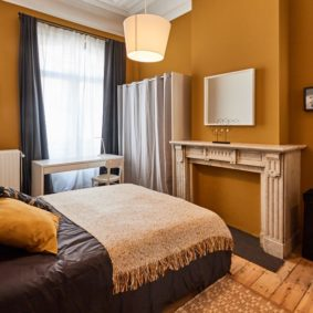 beautifully decorated room with a private shower in a fully refurbished house for expats in Brussels