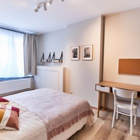 room with comfortable double bed and private shower in coliving house for expats
