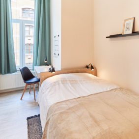 room decorated with style including a private shower in a fully renovated cohabitation house for expats in Brussels