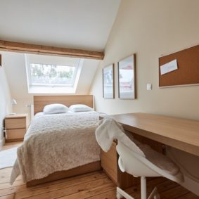 well-decorated room with large dressing and wooden floor in a coliving space in Brussels