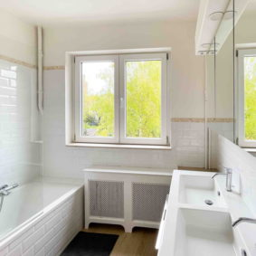 Shared bathroom with double sink and bath tub to share with one other international housemate