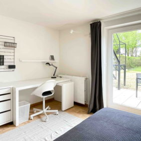 Bright room with high speed internet Wi-Fi, a desk and a chair in a fully furnished shared house in Brussels