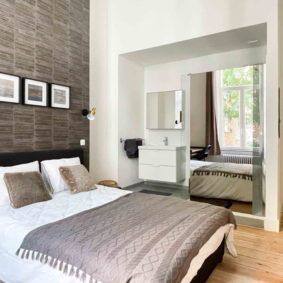 Well-designed bedroom with private ensuite bathroom and desk in renovated house in Sint-Gillis